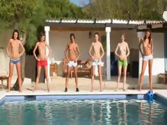 Six naked girls by the pool...